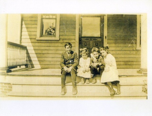 These are the Cooling children on the front porch of our house, probably in the 1920s. The boy second from the right is Walter Cooling, who once stopped in to visit and pointed out that we still had the same clawfoot tub he grew up with! The front door is also the same. Thanks to Robert Hazel for the photograph.